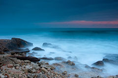 Beautiful rocky sea beach at the sunset Royalty Free Stock Photos