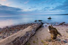 Beautiful rocky sea shore at sunrise or sunset. Stock Photography