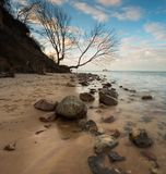 Beautiful rocky sea shore at sunrise or sunset. Stock Images