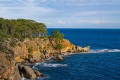 Beautiful rocky steep coast and big waves royalty free stock photos