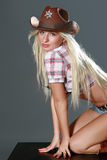 Beautiful rodeo cowgirl in cowboy hat.  Stock Image