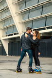 Beautiful roller skater couple with hipster style skating after the rain. Royalty Free Stock Photography