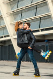 Beautiful roller skater couple with hipster style skating after the rain. Stock Photos