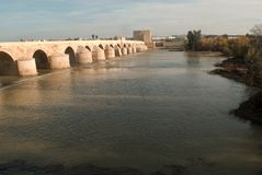 The beautiful Roman bridge over the river Guadalquivir leading to the town of Cordoba in Andalusia. The beauties of modern and classical Spain, with traditions stock photo