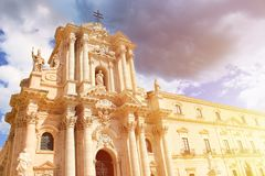 Beautiful Roman Catholic Cathedral of Syracuse in Sicily, Italy taken from below in orange sunset light. The temple. Is part of UNESCO World Heritage. Baroque royalty free stock images