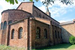 Beautiful roman medieval red brick church San Giovanni Evangelista in Ravenna in Italy royalty free stock photo