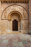 Beautiful romanesque door of San Isidoro Collegiate in leon. Romanesque style door with the carved tympanum called Puerta del Cordero in the Royal San Isidoro Royalty Free Stock Photography