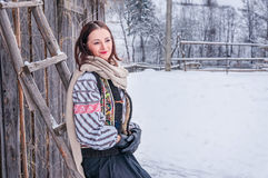 Beautiful romanian girl in traditional costume. In wintertime outdoor Royalty Free Stock Images