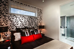 A beautiful romantic bedroom with multi colours cushions and att Stock Photography