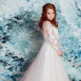 Beautiful and romantic bride in wedding dress with long sleeves. Young redheaded woman in wedding dress stock photography