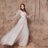 Beautiful and romantic bride in wedding dress with long sleeves. Young redheaded woman in wedding dress royalty free stock photos