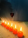 Beautiful romantic candles with red wine dinner time. Relaxing sweet romantic dinner with candles and red wine Royalty Free Stock Photos