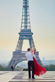 Couple dancing in front of the Eiffel tower in Paris, France Royalty Free Stock Photography