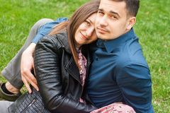 Beautiful romantic couple embracing at spring green park royalty free stock images