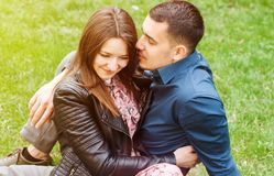 Beautiful romantic couple embracing at spring green park royalty free stock photography