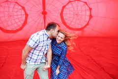 Beautiful romantic couple hugging inside a hot air balloon. Stock Photo