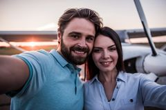 Couple and aircraft stock photography