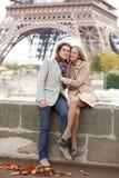 Beautiful romantic couple in Paris. Beautiful romentic couple in Paris near the Eiffel Tower stock photo