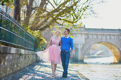 Beautiful romantic couple in Paris near the river Seine Stock Photography