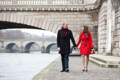 Beautiful romantic couple on a Parisian embankment Royalty Free Stock Photos
