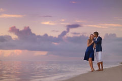 Beautiful romantic couple on a tropical beach Stock Images