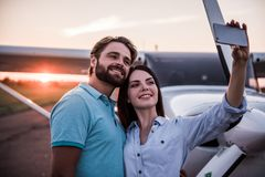 Couple and aircraft stock image