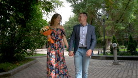 A beautiful romantic couple is walking in the park. Date. stock video footage