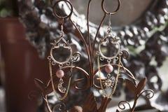Beautiful romantic female earrings Stock Photos
