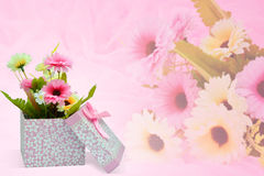 Beautiful romantic gift box and flower on pink background. Royalty Free Stock Image