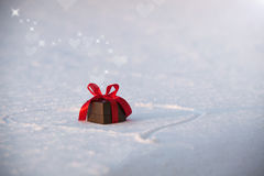 Beautiful romantic gift box on a white snow. Stock Photography