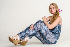 Beautiful romantic girl blonde in summer dress with orchid flower Stock Photography