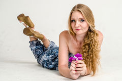 Beautiful romantic girl blonde in summer dress with orchid flower Royalty Free Stock Photo