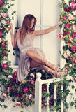 Beautiful romantic thinking woman with long hair sitting and pos Stock Images
