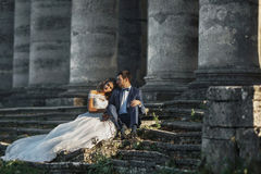 Beautiful romantic valentine couple sitting on old stone stairs Stock Images