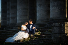 Beautiful romantic valentine couple sitting on old stone stairs Royalty Free Stock Photo