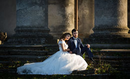 Beautiful romantic valentine couple sitting on old stone stairs Royalty Free Stock Photography