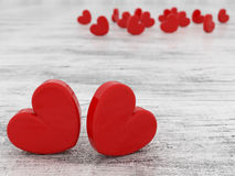 Beautiful romantic Valentine`s day red hearts on wooden background 3d render Stock Photo