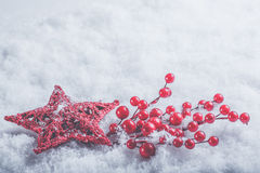 Beautiful romantic vintage red heart with mistletoe berries on a white snow. Christmas, love and St. Valentines Day concept. Stock Photography