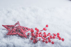 Beautiful romantic vintage red heart with mistletoe berries on a white snow. Christmas, love and St. Valentines Day concept. Royalty Free Stock Photography