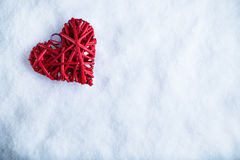 Beautiful romantic vintage red heart on a white snow winter background. Love and St. Valentines Day concept Stock Photos
