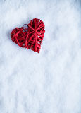Beautiful romantic vintage red heart on a white snow winter background. Love and St. Valentines Day concept.  Stock Images