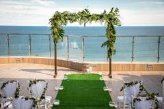 Beautiful Romantic Wedding Ceremony Decorations. Set up near the royalty free stock photos