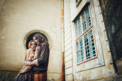 Young couple in love, kissing near vintage metal door stock photos