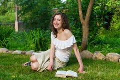 Beautiful romantic woman book outdoors stock images