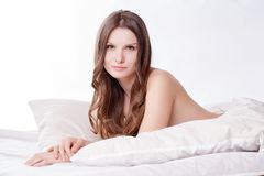 Beautiful romantic woman brunette lying on the bed Royalty Free Stock Photo
