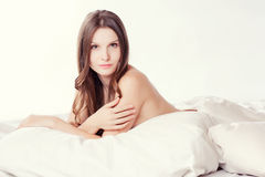 Beautiful romantic woman brunette lying on the bed Royalty Free Stock Image