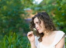 Beautiful romantic woman daisy flower stock photo