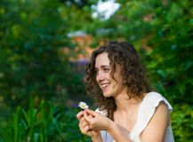 Beautiful romantic woman with daisy flower stock photos