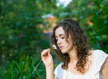 Beautiful romantic woman with daisy flower Stock Photography