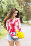 Beautiful romantic woman with flowers bouquet in the park Royalty Free Stock Images